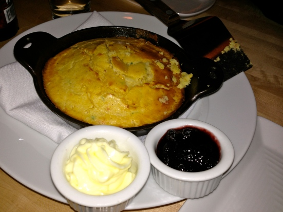 Spicy cornbread in a hot skillet.