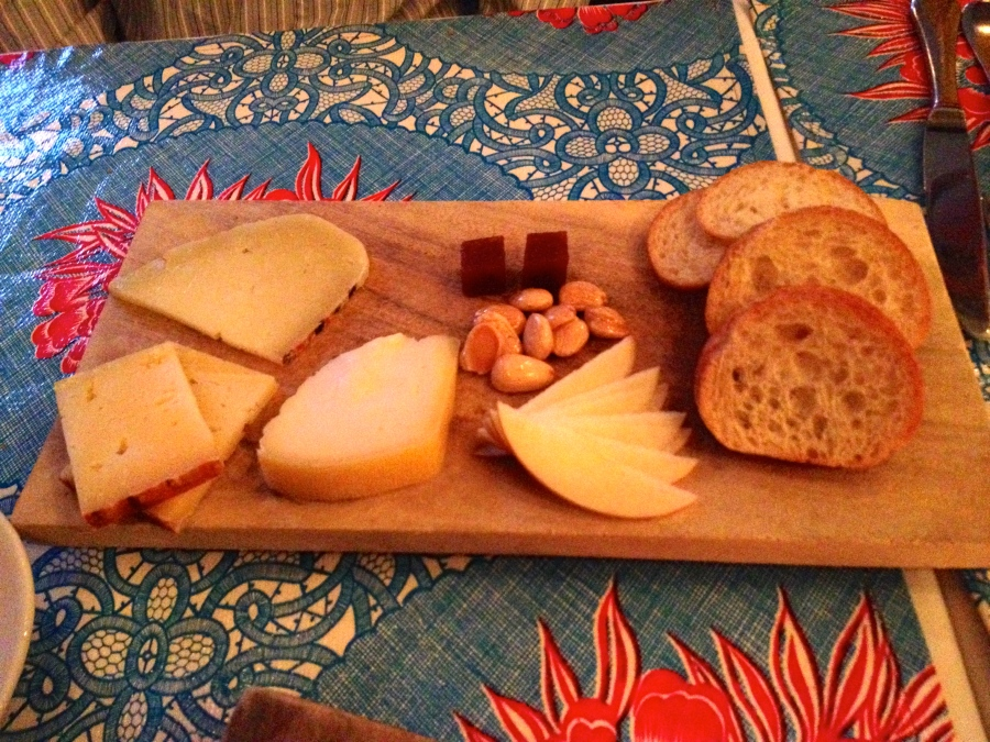 Cheese, almonds, apples, quince and crostini.